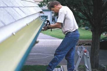 Gutter professional installing new gutters